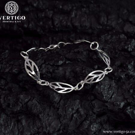 Srebrna, segmentowa bransoletka z ażurowymi liśćmi połączonymi ogniwkami