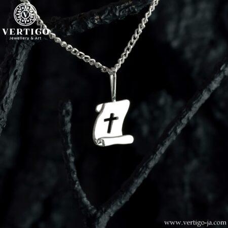Srebrny medalik w kształcie pergaminu z wyciętym krzyżykiem
